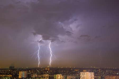 lightning strike: Lightning strike over night city. Moscow, Russia. Stock Photo
