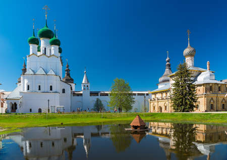 Rostov Kremlin in sunny day. Rostov, Yaroslavl oblast, Russia. Golden Ring of Russia. Church of St. John the Evangelist and Church of the Virgin Hodegetria. Part of the UNESCO World Heritage Site.