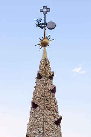 evident: BARCELONA, SPAIN - SEPTEMBER 20, 2014: Design of the roof of Palace Guell - Gaudi Chimney: broken tile mosaics and strange decorated chimneys are evident in his early work.