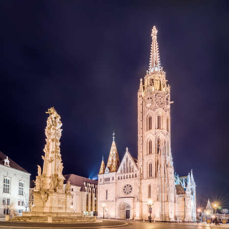 hdri: Night view of the Matthias Church and Statue of Holy Trinity in Budapest, Hungary. HDR image.