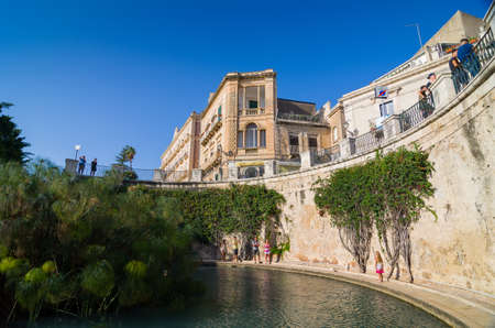 ortigia: SYRACUSE, ITALY - SEPTEMBER 14, 2015: The Arethusas fountain on the island of Ortygia in Syracuse, Sicily, Italy.