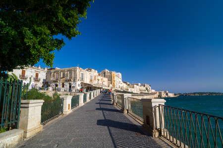 ortigia: SYRACUSE, ITALY - SEPTEMBER 14, 2015: Embankment on the island of Ortygia in Syracuse, Sicily, Italy Editorial