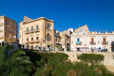 SYRACUSE, ITALY - SEPTEMBER 14, 2015: Italian houses on the island of Ortygia in Syracuse, Sicily, Italy