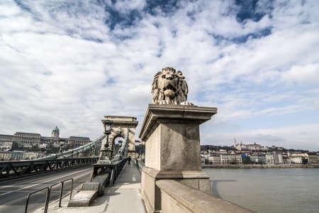 szechenyi: One of the guardian lions on the Szechenyi Chain Bridge. Budapest, Hungary. Stock Photo