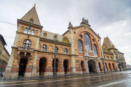 neogothic: BUDAPEST, HUNGARY - FEBRUARY 21, 2016: Facade of the Great Market Hall in Budapest, Hungary. Its the largest indoor market in Budapest. It was designed by Samu Pecz. Built in neogothic style.