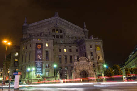 garnier: PARIS - SEPT 17, 2014: Night view of the facade of the Palais Garnier opera house or Paris Opera. It was originally called the Salle des Capucines. Architectural style is Second Empire and Beaux-Arts.