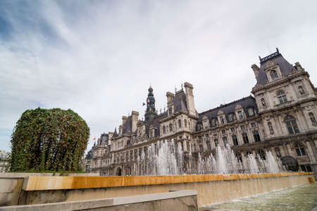 gothic revival: The Hotel de Ville orCity Hall is the building housing the citys local administration. Standing on the place de lHotel-de-Ville in Paris, France. Stock Photo