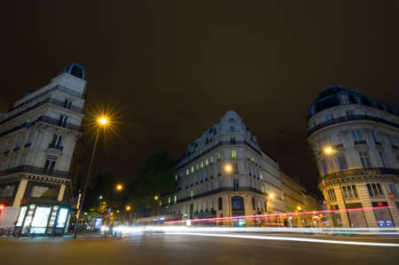 france station: PARIS - SEPT 17, 2014: Night view of the typical french houses near metro station Chaussee dAntin - La Fayette, Paris Metro. Paris, France. Editorial