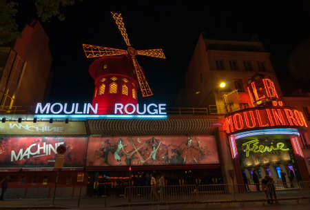 scandalous: PARIS - SEPT 16, 2014: The Moulin Rouge at night. Moulin Rouge or French for Red Mill is a famous cabaret and thater built in 1889, locating in the Paris red-light district of Pigalle. Paris, France.