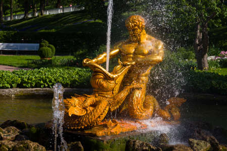 sea monster: PETERHOF, RUSSIA - MAY 26, 2015: Sculptural group of fountain Triton tearing the jaws of the sea monster, performed by model B. Rastrelli. Petergof, Saint Petersburg, Russia. Editorial