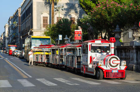 excursion: Catania, Italy - September 13, 2015: Excursion steam train in city center of Catania, Sicily, Italy
