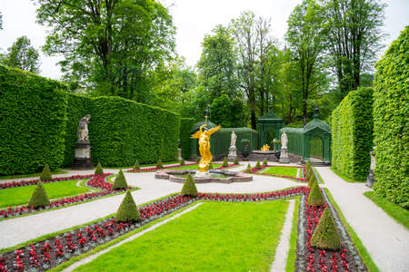 Ettal, Germany - June 5, 2016: Fountain angel in the side garden of the Linderhof Palace. Bavaria, Germany.