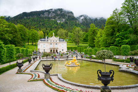 Ettal, Germany - June 5, 2016: Linderhof Palace is a Schloss in Germany, in southwest Bavaria near Ettal Abbey. Fountain group Flora and puttos.