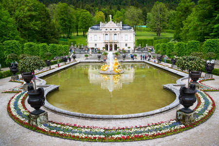 Ettal, Germany - June 5, 2016: Linderhof Palace is a Schloss in Germany, in southwest Bavaria near Ettal Abbey. Fountain group Flora and puttos on the foreground. Editorial