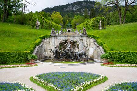 Ettal, Germany - June 5, 2016: Neptune Fountain with horses and Music Pavilion. Linderhof Palace, Southwest Bavaria, Germany