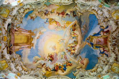 Steingaden, Germany - June 5, 2016: Ceiling of Pilgrimage Church of Wies. It is an oval rococo church, designed in the late 1740s by Dominikus Zimmermann. Region of Upper Bavaria, Germany. Редакционное