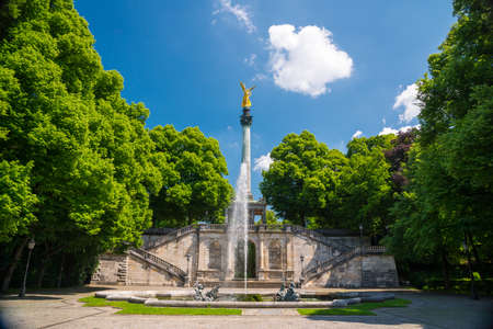 angels fountain: Munich, Germany - June 7, 2016: Monument and golden Angel of Peace in the center of the capital of Bavaria. Munich, Germany. Editorial