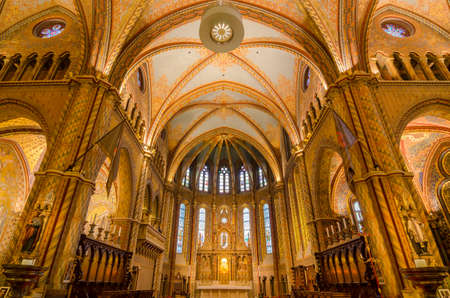 bastion: BUDAPEST, HUNGARY - FEBRUARY 23, 2016: Interior of Matthias Church is a Roman Catholic church located in Budapest, Hungary, in front of the Fishermans Bastion at the heart of Budas Castle District