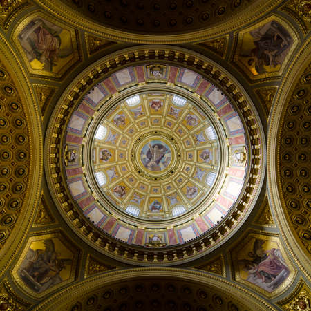 saint stephen cathedral: BUDAPEST, HUNGARY - FEBRUARY 22, 2016: Interior of the cupola. Roman catholic church St. Stephens Basilica. Richly decorated ceiling with mural and gold details. Painted scenes from the Bible.
