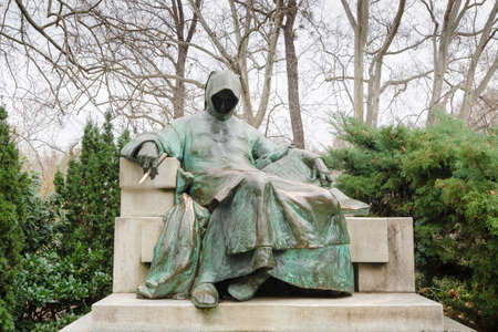 BUDAPEST, HUNGARY - FEBRUARY 23, 2016: Bronze statue of the Anonymous, Vajdahunyad Castle in Budapest, Hungary Editorial
