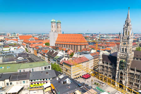 Munich, Germany - June 7, 2016: City view with sky, Frauenkirche, red roofs in Munich near Marienplatz, Bavaria, Germany
