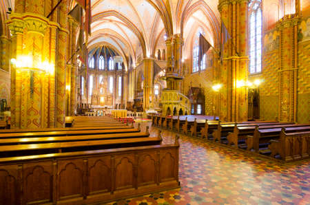 BUDAPEST, HUNGARY - FEBRUARY 23, 2016: Interior of Matthias Church is a Roman Catholic church located in Budapest, Hungary, in front of the Fishermans Bastion at the heart of Budas Castle District