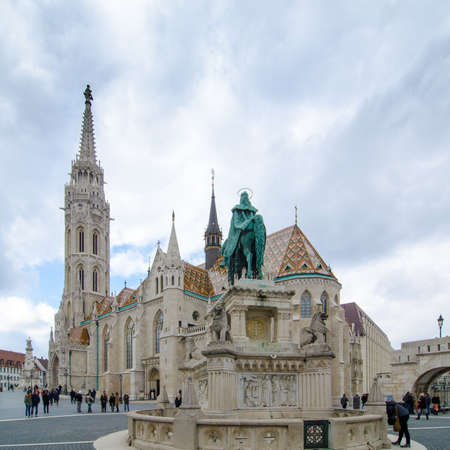 BUDAPEST, HUNGARY - FEBRUARY 20, 2016: Matthias Church is a Roman Catholic church located in Budapest, Hungary, in front of the Fishermans Bastion at the heart of Budas Castle District Editorial