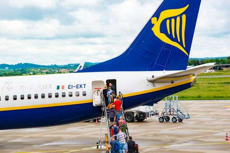 Munich, Germany - June 8. 2016: Passengers boarding Ryanair flight in airport of Munich