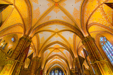 BUDAPEST, HUNGARY - FEBRUARY 23, 2016: Inner decorations, arcades and ceiling of the St Matthias Church