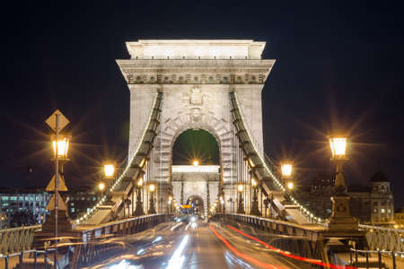 light chains: BUDAPEST, HUNGARY - FEBRUARY 22, 2016: Beautiful night Budapest, the Chain bridge across the Danube river in lights and starry sky, cityscape suitable for cover or desktop background