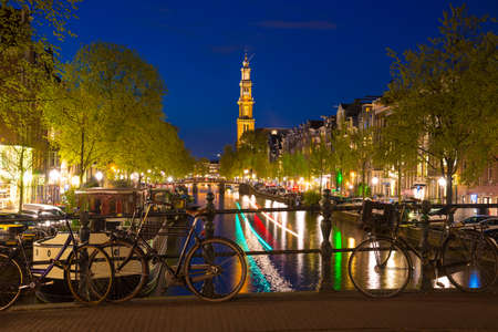Westerkerk on the Prinsengracht Canal in Amsterdam at Twilight, the Netherlands.