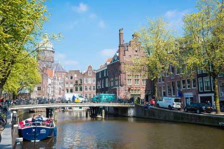 Amsterdam canals with bridges, boats and typical Dutch houses, Netherlands. Editorial