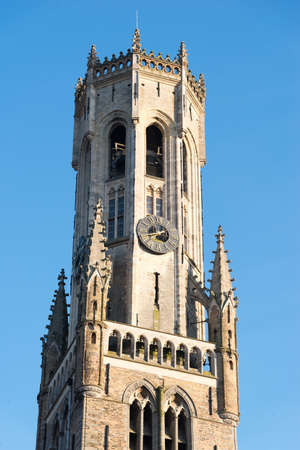 Detail of the Belfort van Bruges - Bruges Belfry in the Grote Markt in the city centre in Bruges, Belgium. Medieval stone crockets and finials line the bell tower. Stock Photo