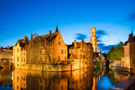 Bruges, Belgium - April 17, 2017: View from the Rozenhoedkaai of the Old Town of Bruges at dusk, Belgium Editorial