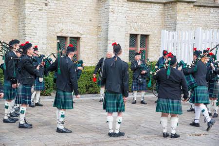 Ghent, Belgium - April 16, 2017: Scottish bagpipe band on the street in Ghent, Belgium