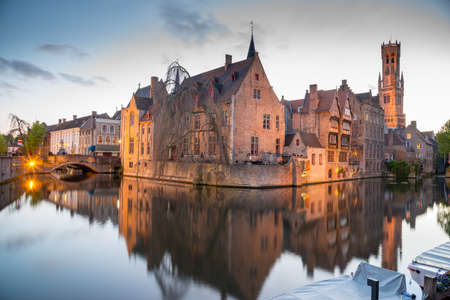 Bruges, Belgium - April 17, 2017: View from the Rozenhoedkaai of the Old Town of Bruges at dusk