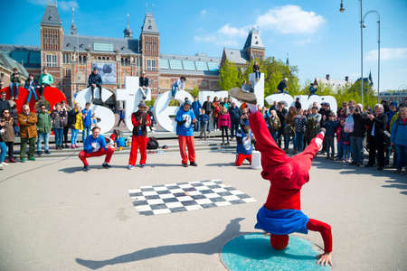 Youth break dancing on city streets. Street festival breakdance. Amsterdam, Netherlands.