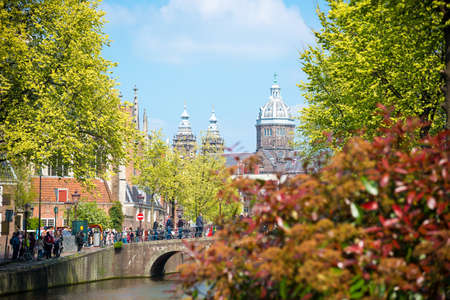 Bridge, canal and St. Nicolas Church in Amsterdam. Amsterdam is the capital and most populous city of the Netherlands Stock Photo