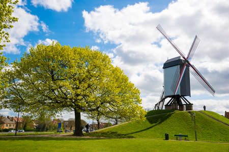 Windmill in Bruges, Northern Europe, Belgium. Historical building preserved for tourism in the city, along the canals.