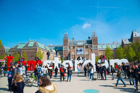 Amsterdam, Netherlands - April 20, 2017: Rijksmuseum - National state museum. And city icon I Amsterdam slogan on Museumplein. Editorial