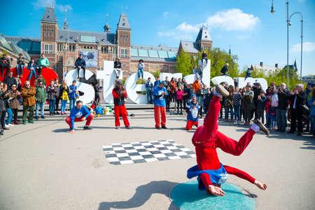 Amsterdam, Netherlands - April 20, 2017: Youth break dancing on city streets in Amsterdam. Street festival breakdance. Editorial