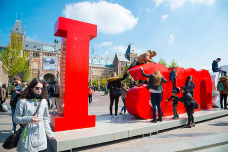 Amsterdam, Netherlands - April 20, 2017: The I Amsterdam sign in front of the Rijksmuseum is an attraction for tourists wanting to take pictures