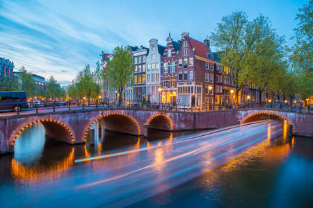 Bridge over Keizersgracht - Emperors canal in Amsterdam, The Netherlands at twilight. HDR image.