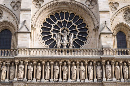 The western rose window, kings statues and architectural details of the catholic cathedral Notre-Dame de Paris. Built in French Gothic architecture, and it is among the largest and most famous church.