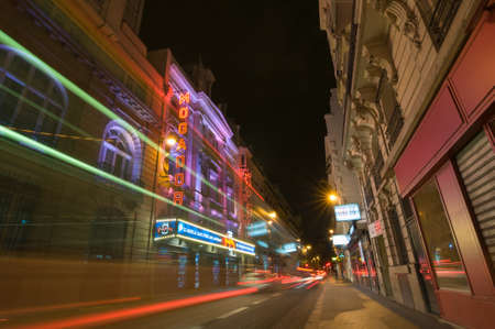 PARIS - SEPT 17, 2014: Traffic lights and night view of the Theatre Megador. It founded in 1913 and designed by Bertie Crewe, is a Parisian music hall theatre located at 25, rue de Mogador, Paris. 報道画像