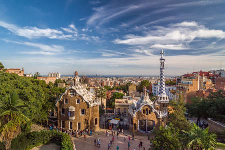Barcelona, Spain - September 20, 2014: Park Guell by architect Antoni Gaudi in Barcelona, Catalonia, Spain. The two buildings at the entrance of the park. Editorial