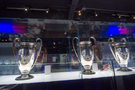 Barcelona, Spain - September 22, 2014: UEFA Champions League Cup in museum. UEFA Cup - trophy awarded annually by UEFA to the football club that wins the UEFA Champions League. Camp Nou, Barcelona.