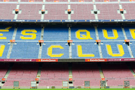 Barcelona, Spain - September 22, 2014: One of the stands displaying Barcelona's motto, Mes que un club, meaning More than a club. Camp Nou, Barcelona, Spain.