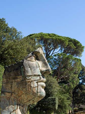 Florence, Italy - April 14, 2013: Sculpture Tindaro Screpolato by Igor Mitoraj in Boboli Gardens, Florence, Tuscany, Italy. Unesco World Heritage site.