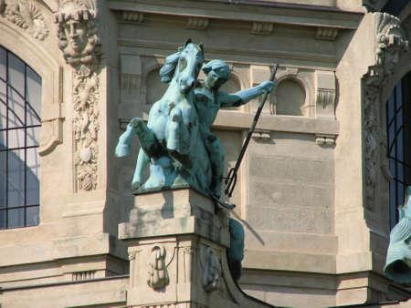 szechenyi: Statue by the walls of Szechenyi baths